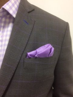 Grey checked jacket with purple accents testimonials